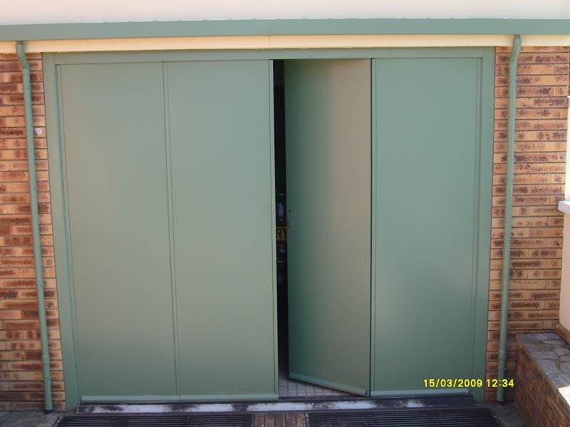 Atelier de serrurerie metallerie d corative for Porte garage 60